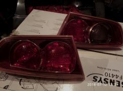 Ліхтарі до Мітсубісі Лансер 10 в кришку багажника